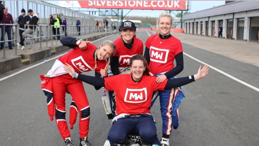 Team Motorsport Woman celebrating in the pits