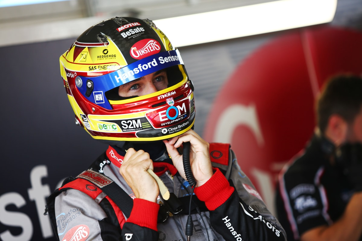 Ingram putting helmet on before race
