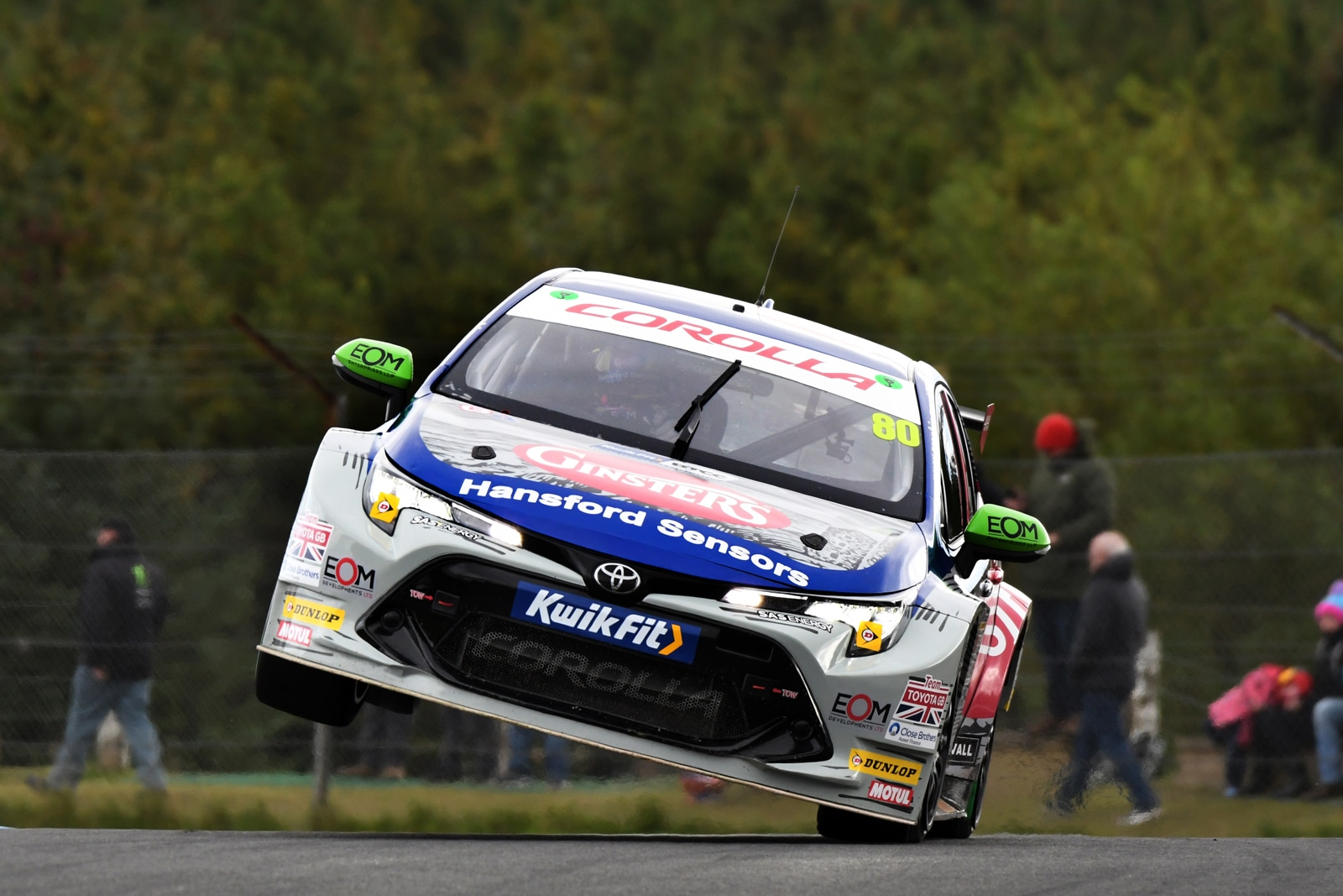 Ingrams car travelling out of a corner with two wheels high off the ground