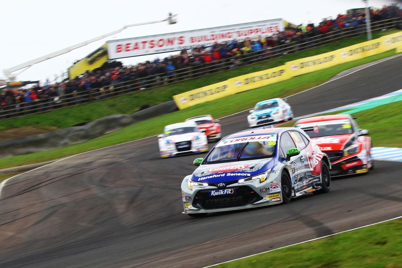 Ingram taking a corner at speed with cars trailing