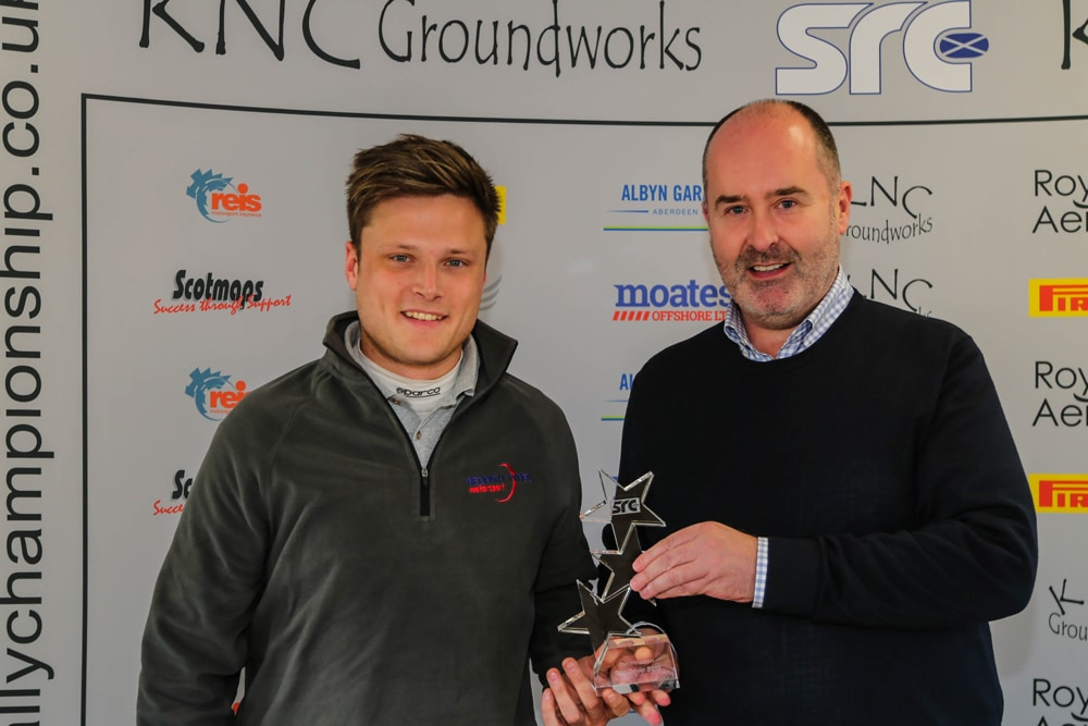 Max Redpath receiving the Star Driver Award from 2001 WRC champion Robert Reid